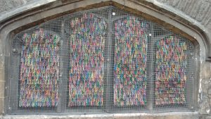 Bristol street art: Colourful twist ties in old city wall window