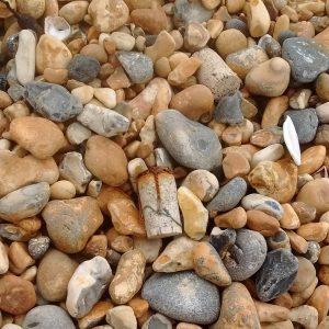 Cork on pebble beach in Brighton