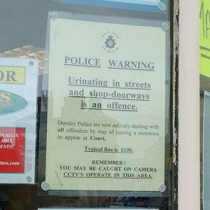 Anti-urinating notice in post office window