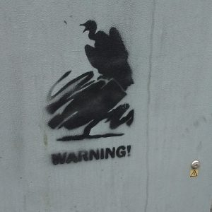 Stencilled graffiti of a vulture atop a scribbled tree, the Conservative party symbol.