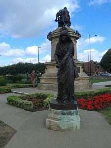 Statue of Lady Macbeth, trying to clean her soiled hands.