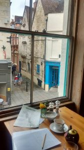 Table at window with street view of Stroud.