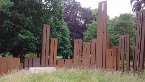 Purposefully rusted metal monuments in Gheluvelt Park