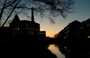 Sunset over the restored mill buildings in Ebley