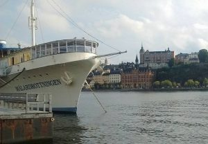 Stockholm boat with classic buildings in the background