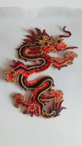 Stitched emblem of a Chinese-style red and black dragon