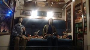 Dummies of Harry and Ron in the Hogwarts Express with various goodies from the trolley.