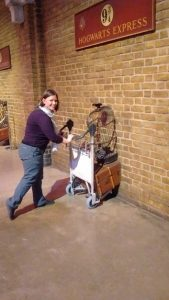 I posed with the trolley going through the wall at Platform 9 and 3/4.