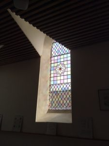 Stained glass window in a wedge of ceiling