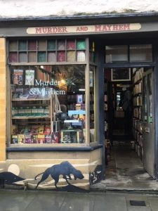 Murder and Mayhem bookshop, with a hound painted on the front.