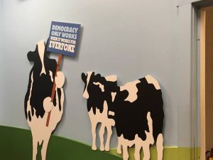 Mrs. Spokescow lobbies for voting rights in a Ben & Jerry's factory display