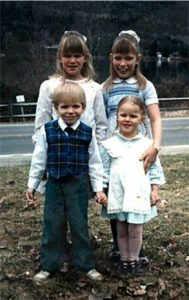 Photo of us four children, across the street from the lake.