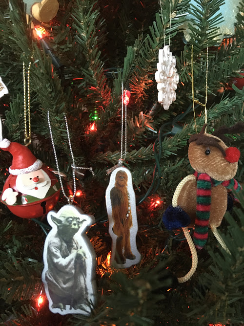 Christmas tree ornaments: Santa bell, Yoda, Chewbacca, snowflake, fuzzy reindeer